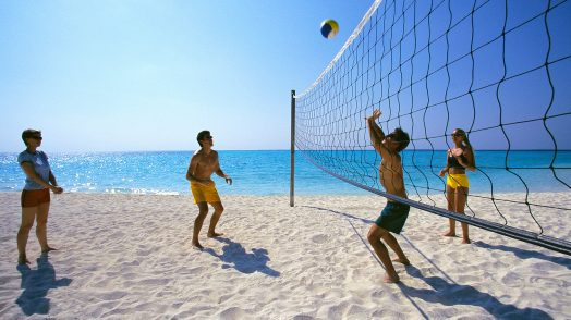 Two Couples Playing Volleyball